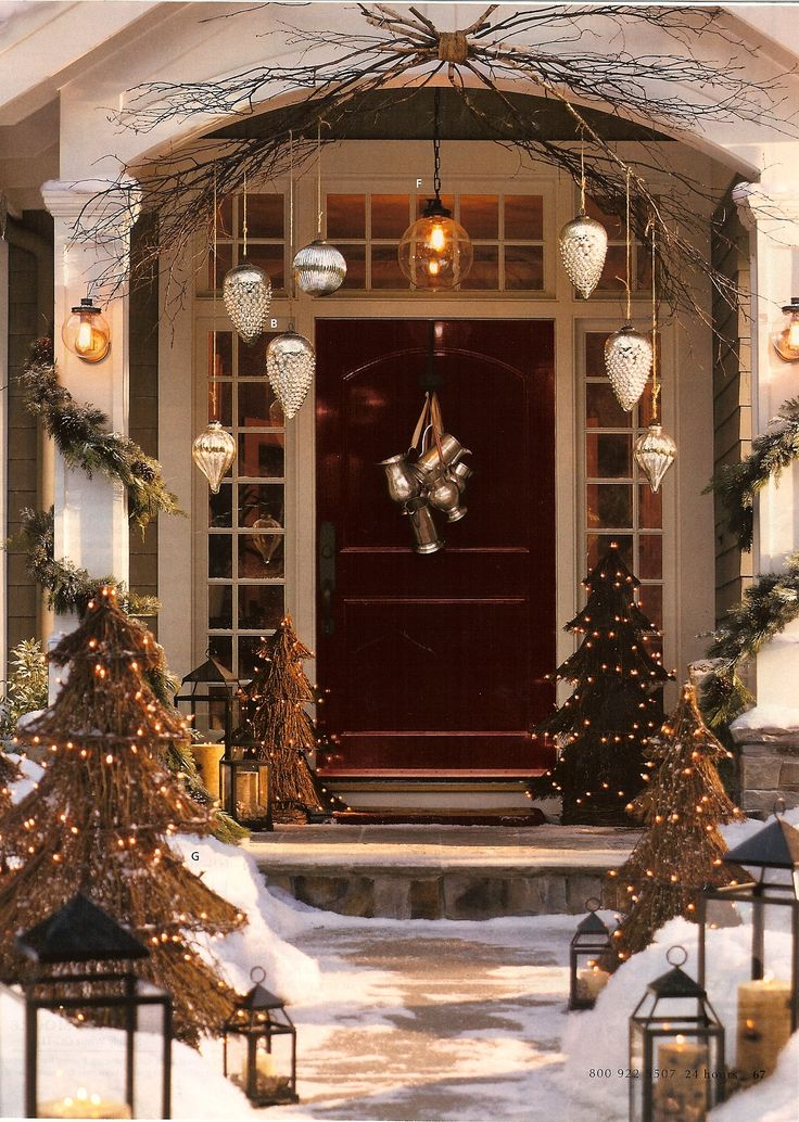 Gorgeous and luxury Christmas decoration for front door, featured with hanging ornaments, branches, evergreen and decorated Christmas trees. / Natural Style Christmas door decorating ideas / Lisa Taylor on Fuseink