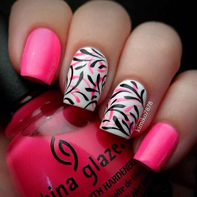 Fun summer China Glaze pink with 2 accent nails (middle/ring) in white w/pink and black design.