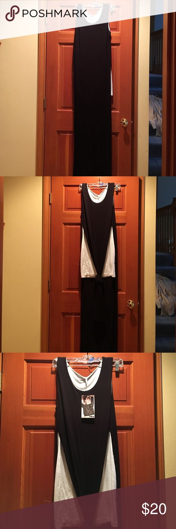 Long maxi black dress with slits Long black maxi dress with large slits but lined with a shorter white dress to be worn as a dress alone or over jeans as well. Brand new, never worn. Dresses Maxi