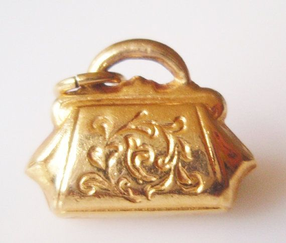 This is a small hollow vintage 9ct gold Handbag or Purse charm. hallmarked 9ct gold Year 1971