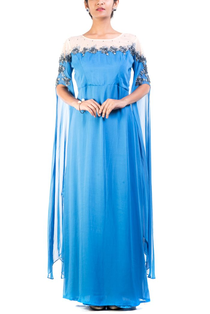 Featuring a floral embroidered, steel blue dress with cape like sleeves. Yoke and sleeves has been beautifully embroidered using sequins and beads