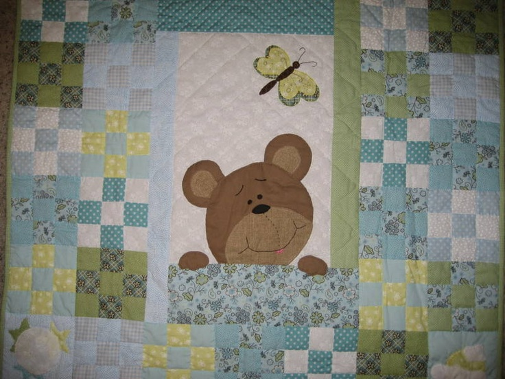 Teddy Bear Quilt made by Linda Goodwin for our new baby .Copied from another pin I pinned earlier. I couldn't find the pattern or the name of the original quilter who made the quilt so I changed it a little and free handed the bear and butterfly. Thank you Pinterest for the idea.