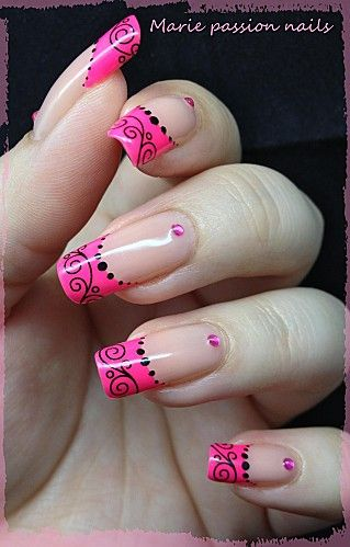 Fancy pink french tip nails with rhinestone accents
