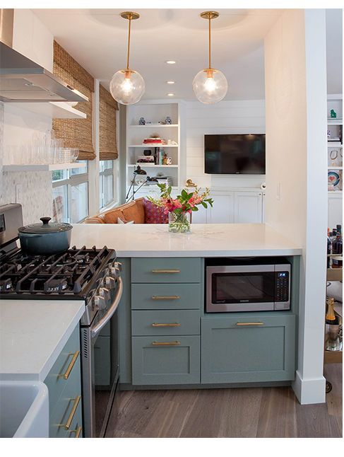 Love this kitchen cabinet color. (Image via @dominomag)