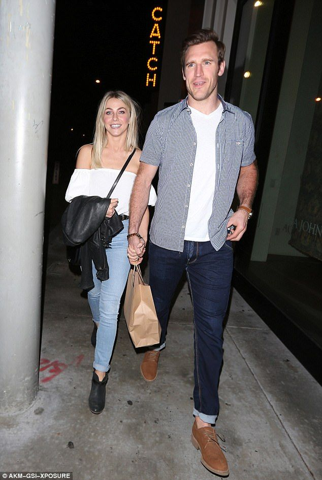 Betrothed: Julianne Hough bared her shoulders in a white flounce top on date with her fian...