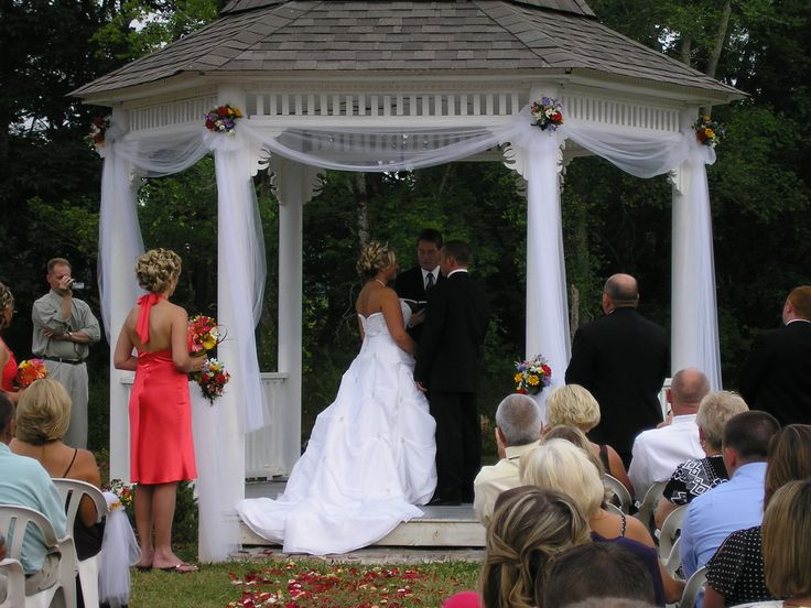 Wedding Gazebo Decorations- a little white tulle and flowers (no over kill) and a unity candle table needed for wedding ceremony. I like the sashes with flowers.