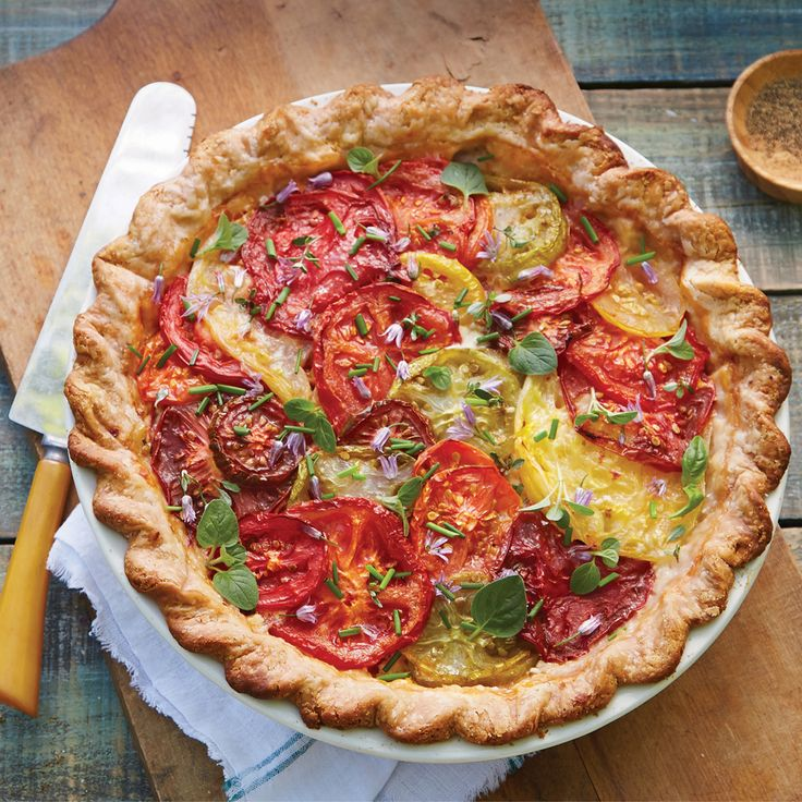A tomato pie is a delicious creation--almost as good as the first tomato sandwich of the season. Every summer, I look forward to it. If you've never heard of a tomato pie, think of it as an eggless quiche. Trust me, it will become your new favorite.