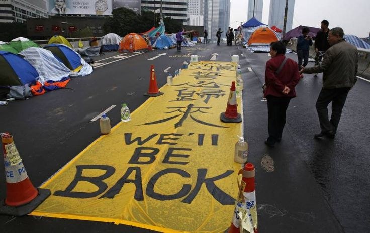 """""""Hong Kong police arrested pro-democracy activists and cleared out most of the protest area on Thursday, marking an end to more than two months of street demonstrations, Reuters reports.  But while Hong Kong's turbulent democracy protests may have come to an end, the protesters who flooded Civic Square in central Hong Kong have a message for government officials: This isn't over."""""""