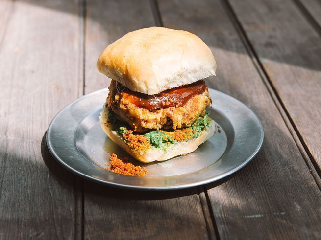 Indian Vada Pav-Veggie Burger 8 med yellow potatoes (4 lb.) 2 T mustard oil 2 t mustard seeds 2 t cumin seeds Pinch of asafoetida (hing) 4-6 green Thai chiles thinly sliced 1 sm onion minced 1 c 1 1⁄2 t ground turmeric, divided 1 t ground coriander 12 curry leaves 1⁄2 c chopped cilantro Kosher salt 3 c chickpea flour 1 t baking soda Canola oil for frying 12 sm soft rolls,