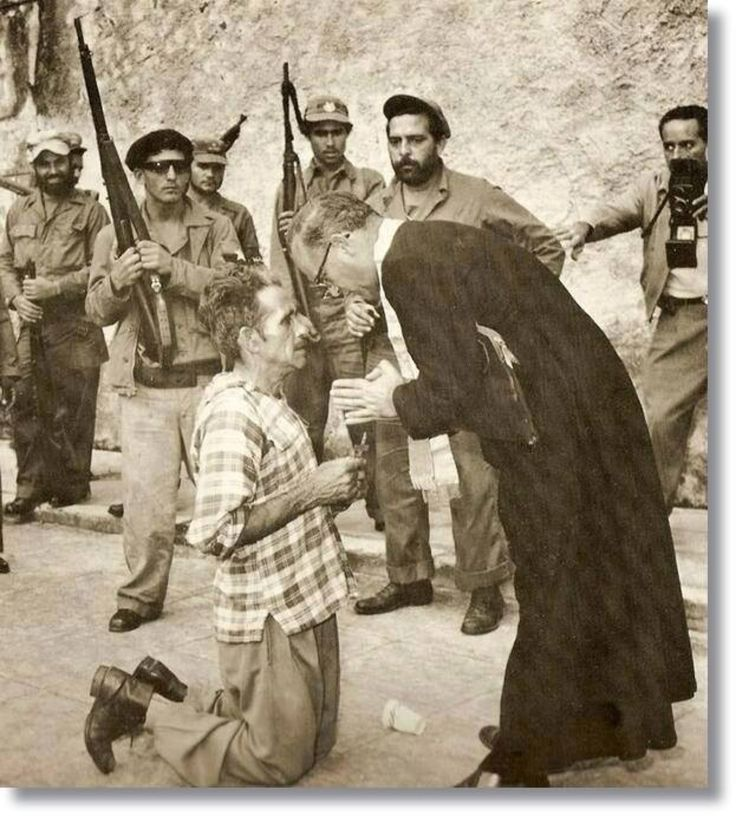 Picture of a innocent Cuban receiving spiritual comfort before being shot dead by communists working for Fidel Castro.