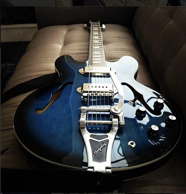 Blue Epiphone Casino with a Bigsby Vibrato.