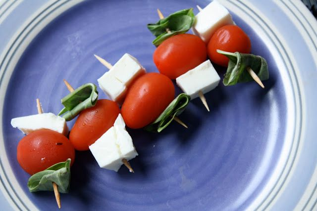 Caprese (mozz cheese, cherry tomatoes, basil on toothpicks) appetizer