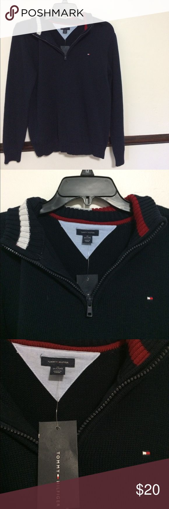 Tommy Hilfiger Polo Sweater Navy Blue Classic Polo Sweater by Tommy Hilfiger. It is brand new, with the tag, never been worn! Fits XS-M sized women. Also can fit men but might be a little tighter. Very classic design, Red and white around collar and has little logo on left chest area. Overall- great steal!! ( says Size M for 12-14 but fits perfectly on any other sizes) Tommy Hilfiger Sweaters Zip Up