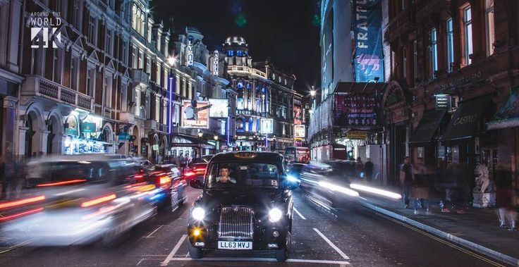 A moment of calmness sets upon Shaftesbury Avenue as a taxi driver stops at the red light.