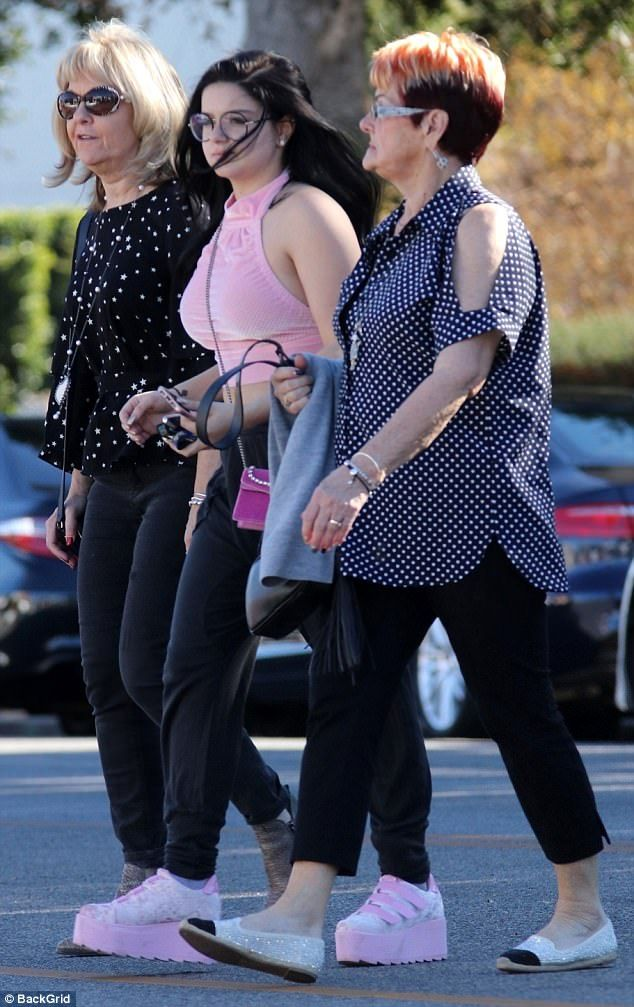 All in the family: Ariel Winter walked to lunch with members of boyfriend's Levi Meaden's family on Wednesday