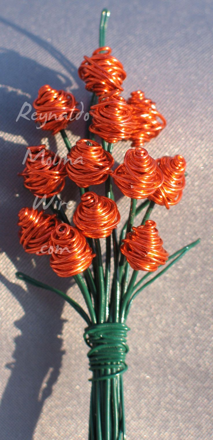 Wire sculpture of a miniature bouquet of roses in the color orange