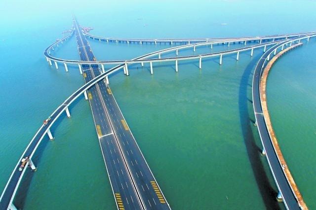 Jiaozhou Bay Bridge (or Qingdao Haiwan Bridge) is a 26.7 km (16.6 mi) long  roadway bridge in eastern China's Shandong province, which is part of th