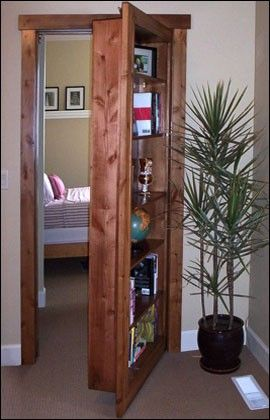 """Hidden doors -- This company makes cabinets, bookshelves and anything you can think of that fits your existing doorjambs thus hiding the door (and also making use of the space). If you click through checkout the """"gun cabinet"""" door. Lots of great ideas."""