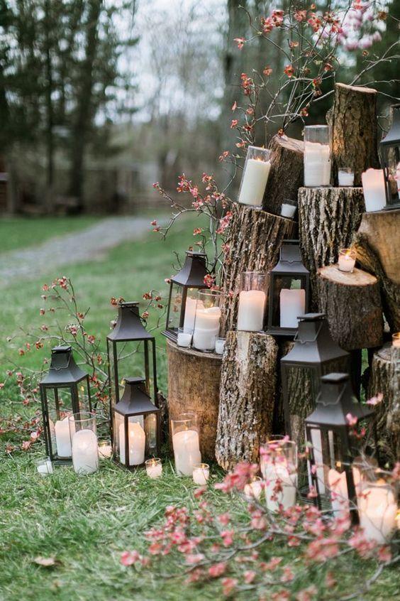lantern and candle ceremony backdrop - photo by Emily Wren | woodland wedding decoration