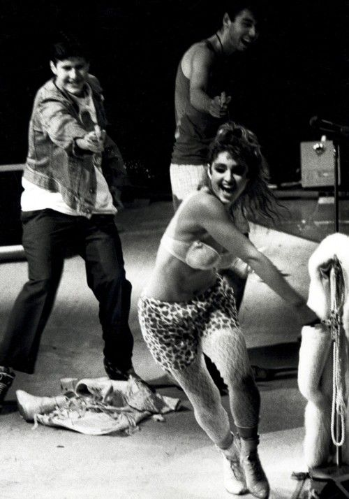 Happier times. MCA and Ad Rock (I think) with Madonna on stage the final night of the Virgin Tour.
