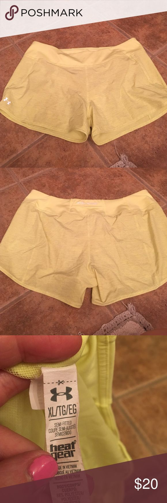 Worn once Neon yellow under armour shorts! Size xl workout running shorts. Literally worn one time, in perfect condition! The lighting doesn't show how neon they are. They are neon yellow and super cute! Under Armour Shorts