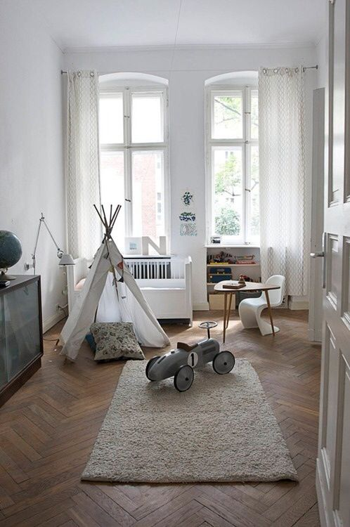 the white walls, the teepee, the wood floor and the rug.