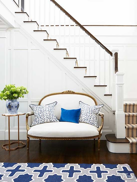 Add some oomph to a white settee with lush velvet pillows.