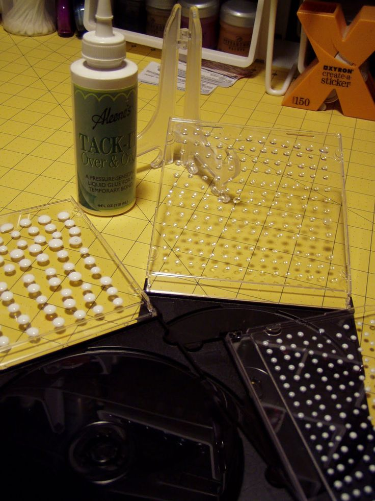 """Smart Idea: Make glue dots: Using Aleene's """"Tack-It Over and Over"""" glue, make dots in any size or shape on the inside cover of an empty CD cover. Let dry. Peel off as needed."""