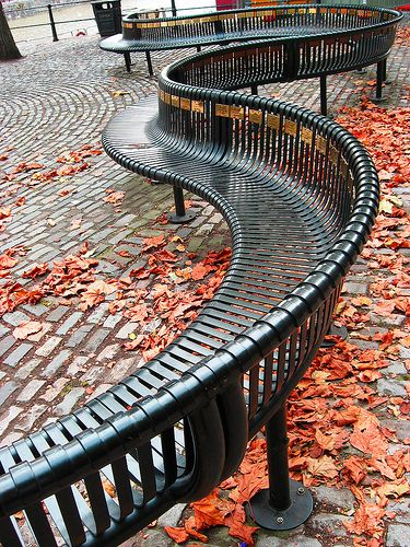 A bench that swirls through the park