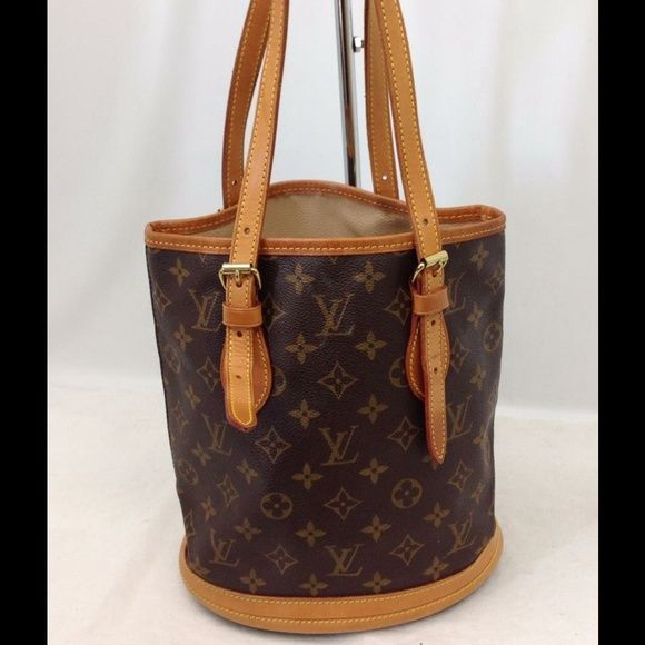 Authentic Louis Vuitton Monogram Bucket Bag 100% Authentic Louis Vuitton Bucket Bag.   Pockets are a little sticky.  But, the bag is very stylish with lots of miles left! You will get tons of compliments! Louis Vuitton Bags Shoulder Bags