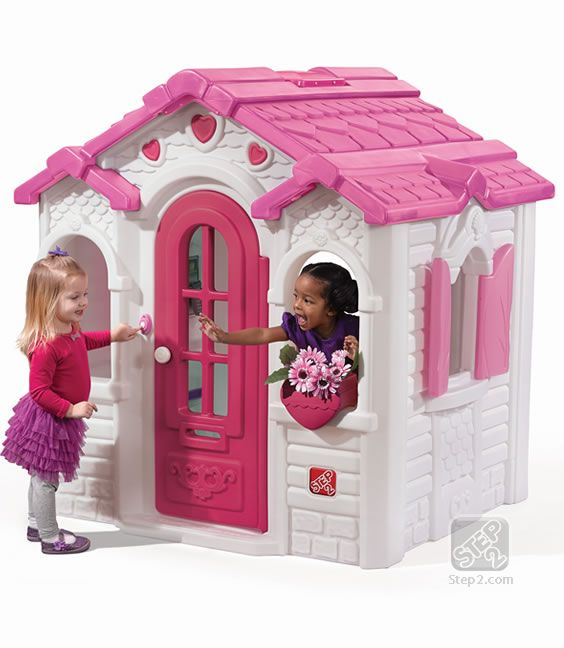 Step2 Sweetheart Playhouse brightens up the backyard with pink! This playhouse has a full size door and working shutters that children can easily open and close.