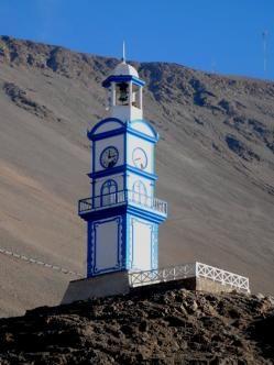 Torre Reloj de Pisagua (Chile) La Torre Reloj de Pisagua es una torre ubicada en Pisagua, comuna de Huara, Provincia del Tamarugal, Región de Tarapacá, Chile. Fue declarada Monumento Nacional de Chile, en la categoría de Monumento Histórico