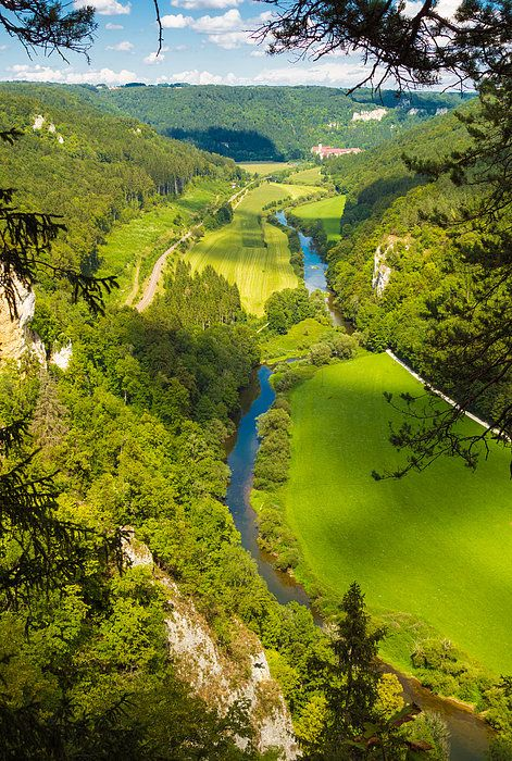 Danube valley in Germany, beautiful landscape with blue river, trees and bright green meadows. Donautal, Blick vom Knopfmacherfelsen in Richtung Beuron.  Available as fine art print or canvas print  with 30 days money back guarantee. (c) Matthias Hauser hauserfoto.com