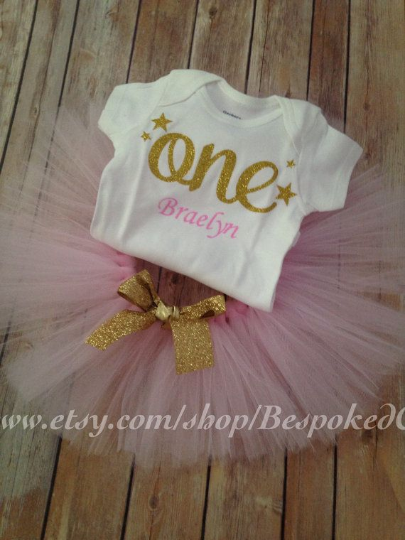 This gorgeous glitter One top is paired with a beautiful soft pink tutu. Can include a small gold bow for her hair. $25