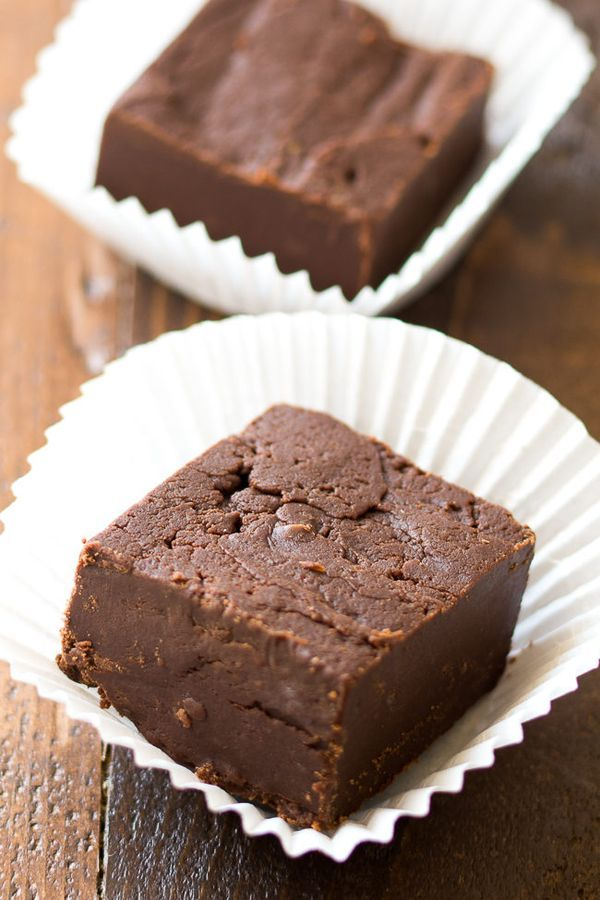Easy 3 Ingredient Fudge Recipe - Make this easy 3-ingredient fudge by warming just a few simple ingredients in the microwave. This is one of my fave Pinterest dessert finds!