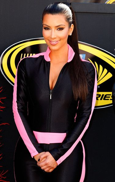 Television personality Kim Kardashian stands on stage during pre race festivities prior to the start of the NASCAR Sprint Cup Series Shelby American at Las Vegas Motor Speedway on February 28, 2010 in Las Vegas, Nevada.