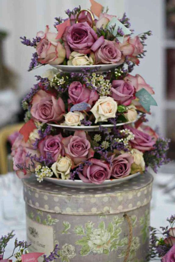Use a vintage tiered cake stand for a fabulous floral centre piece