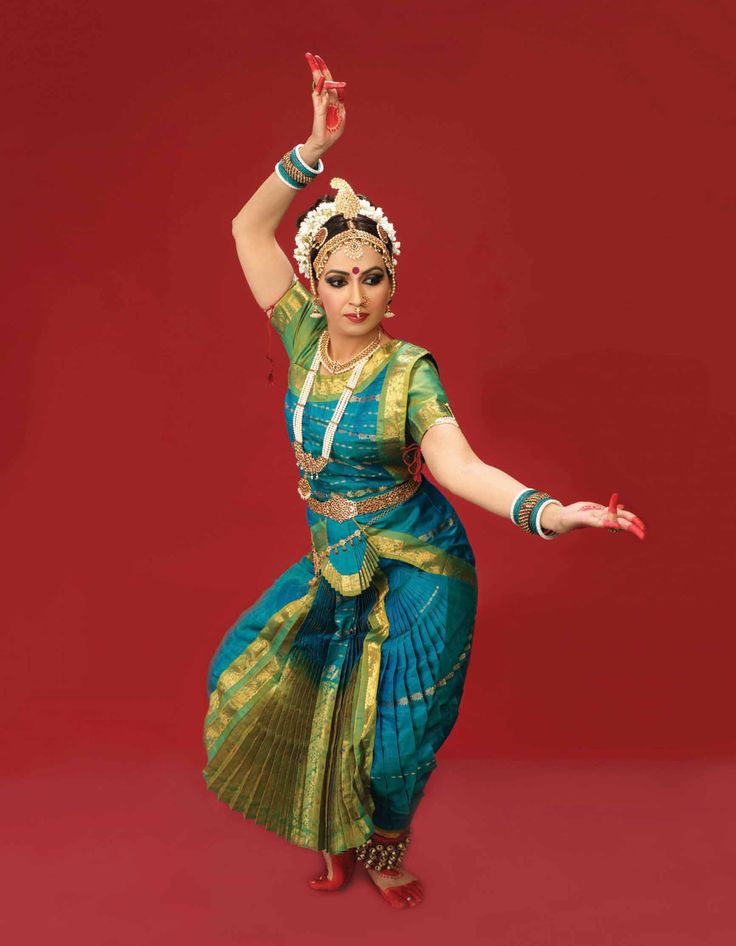 World of Dance.  The colors on this costume are gorgeous; one of my classmates has one just like it.  Everything looks like Bharatanatyam except the headress--I don't know if this is a different style or if it's borrowed from Odissi.