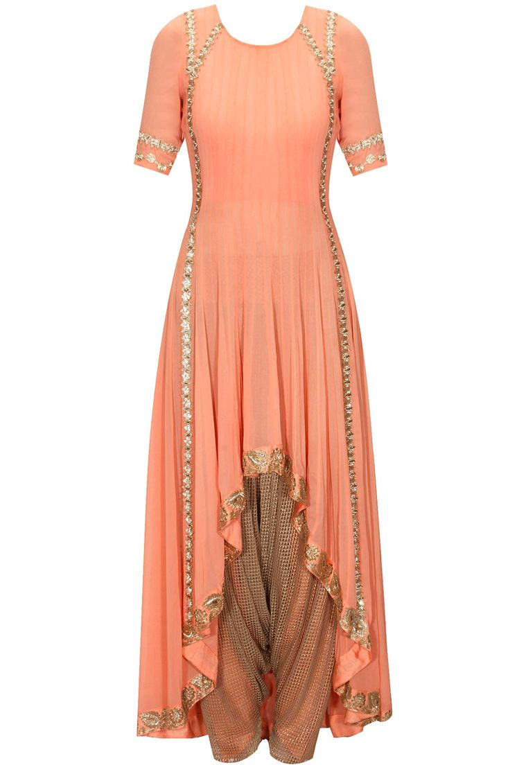 Coral pink high-low kurta with gold dhoti pants available only at Pernia's Pop-up Shop.