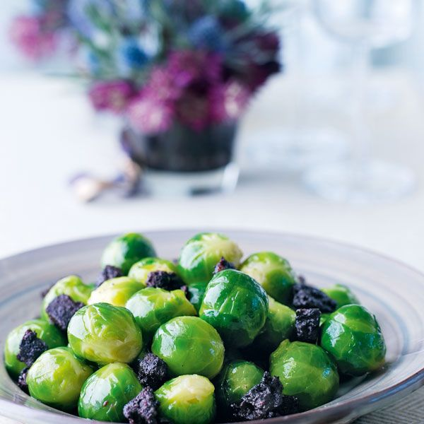 Replacing bacon with black pudding gives this brussels sprouts side a Scottish twist.