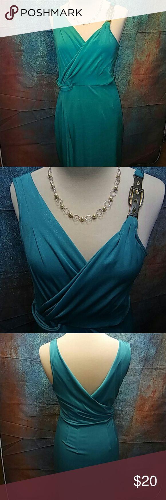 Jennifer Lopez green dress Beautiful green v neckline in the front and back. Brass buckle on left shoulder. Jennifer Lopez Dresses Midi