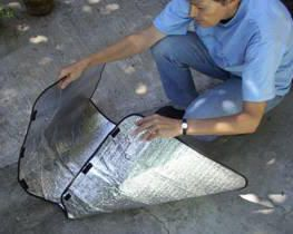 Solar cooking with a windshield shade.  (When I did this, I got it to about 280 degrees.)