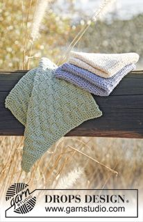 "Knitted DROPS cloths with 3 different textured patterns in ""Safran"" ~ DROPS Design"