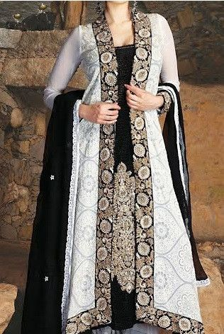 A statement of Elegance! Beautiful3 layered white and black suitwith zari and threadwork. Customized dresses made with high quality fabric & expert workma