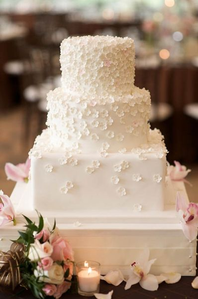 blossom cake- like the contrast between square bottom and round tops.