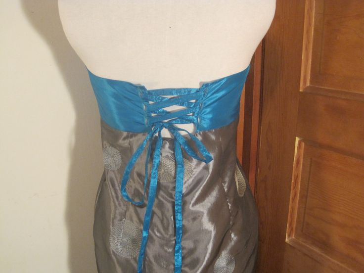 Back of turquoise and silver dress.