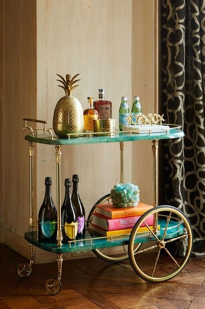A vintage bar cart in the library holds more than just craft-cocktail accoutrements, including entertaining accessories and such games as Jonathan Adler's Tic-Tac-Toe set | archdigest.com