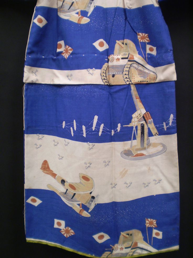 This boy's kimono has been handed down from an older sibling. You can clearly see the tuck in the center where the length of the garment has been shortened. This can be adjusted as the child gets older. Sleeves could also be shortened.