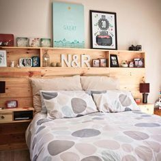 This pallet headboard is designed not only as a headboard but also to provide plenty of shelving for storage. Even the bedside shelves are built into the headboard