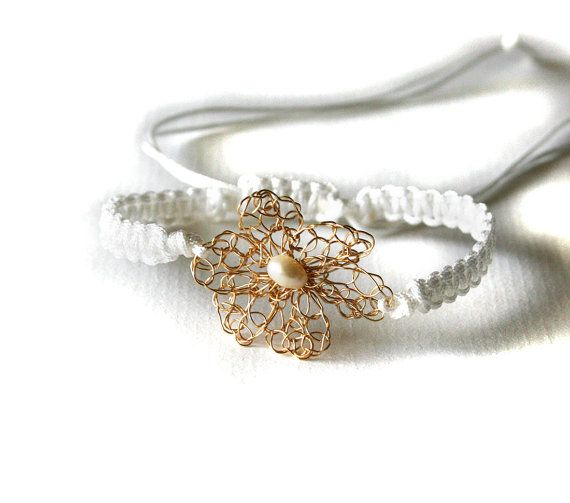 #Handmade Macrame Bracelet Adjustable White With Gold #Crochet #Flower And Freshwater Pearl:  Easy to wear makrame bracelet.   It has a wire crocheted gold colored flower and ... #jewelry #boho #etsy #epiconetsy #shopping #shopsmall #jewelryonetsy #etsyseller